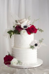 Buttercream wedding cake with diamond quilting design and fresh flowers